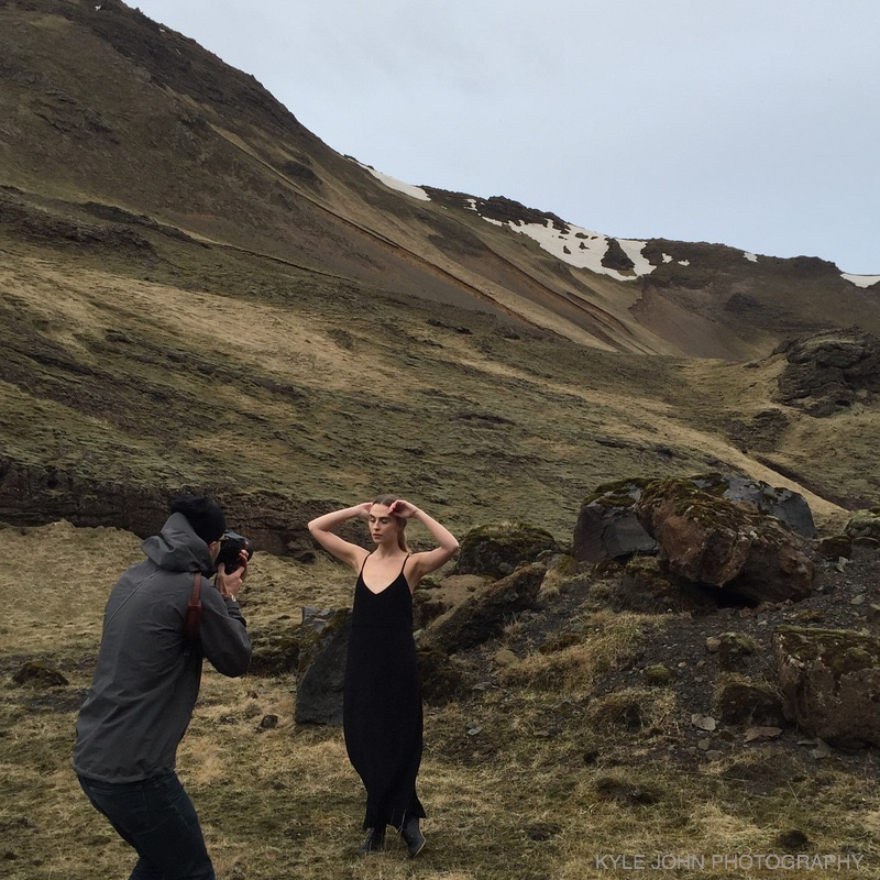 Nika Vaughan Bridal Artists Photographer with model on side of mountain in Iceland