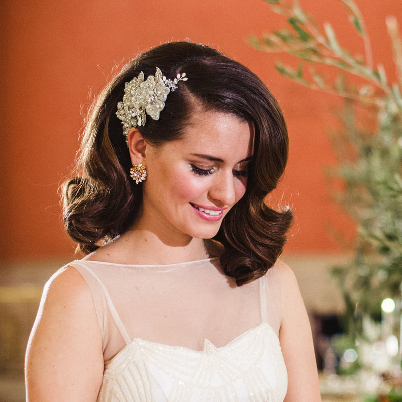 Vintage inspired brunette bride with tulle skirt and floral headpiece