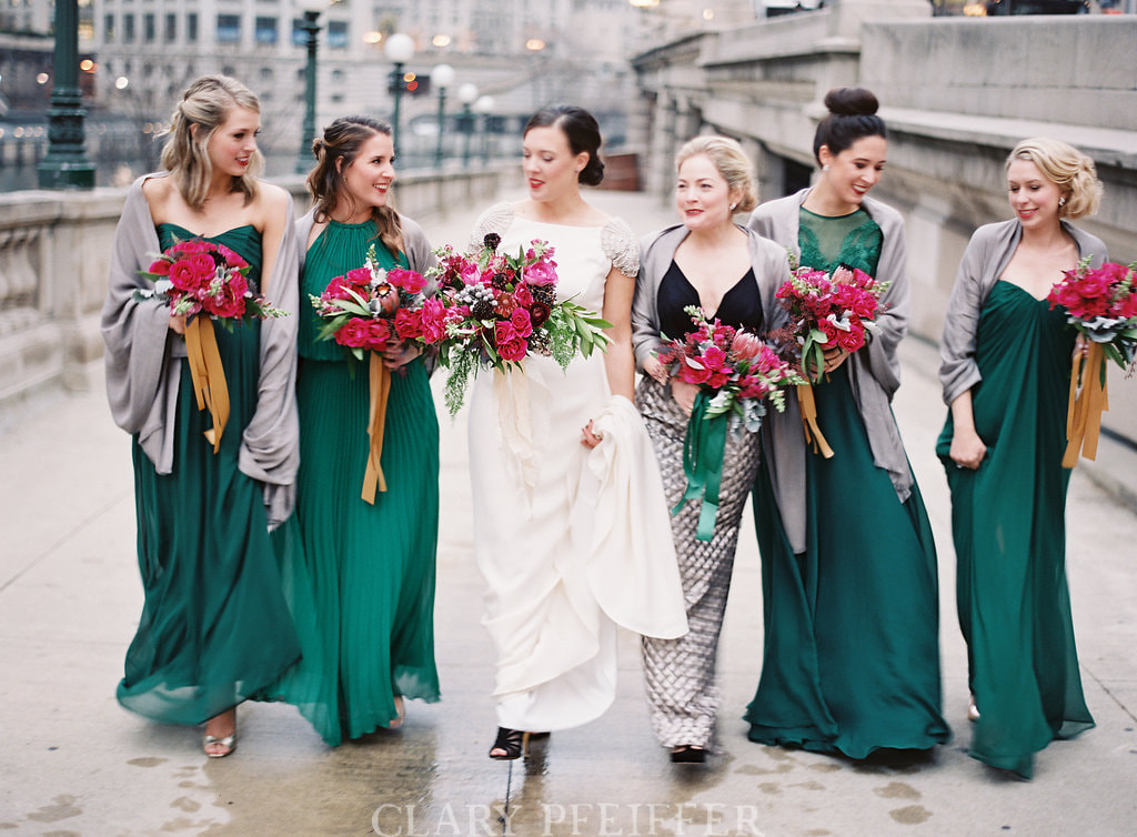 Winter bridal party walking in Chicago. Makeup and Hair by Nika Vaughan Bridal Artists