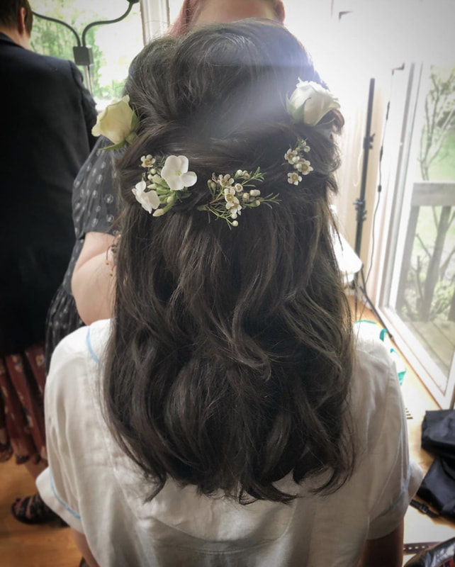 Brunette half up wedding hair style with floral crown
